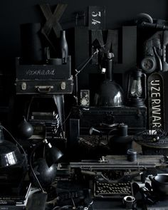 prop styling: black, texture, typography, vintage typewriter, books, suitcase, sign