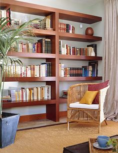 Love the design hate the color of built-ins http://www.shelterness.com/50-ideas-to-organize-a-home-library-in-a-living-room/