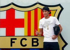 Neymar in front of the club logo/colours of FC Barcelona.