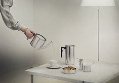 Launched in 1967, the Stelton Cylinda Line made an immediate splash. The simplicity of its cylindrical shapes and specially designed plastic handles characterized the series which, with its brushed steel surfaces, stood in striking contrast to the highly polished curves of its day. Designed by Arne Jacobsen.