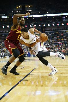Anthony Davis #23 of the New Orleans Pelicans drives the ball around Tristan Thompson #13 of the Cleveland Cavaliers at Smoothie King Center on December 12, 2014 in New Orleans, Louisiana.