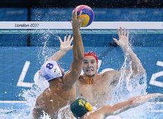 Evagelos Delakas of Greece (No. 8 white cap) scored this goal past Australia's Joel Dennerley, but Australia won the men's water polo preliminary round match, 13-8.
