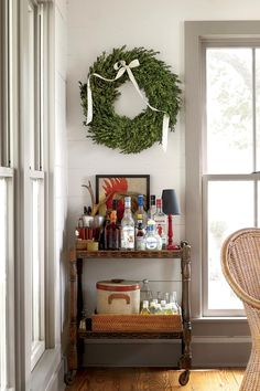 Classic Portable Bar - Handsome Bar Cart Ideas - Southernliving. In one corner of the dining room, a rolling cart holds a full bar all set for holiday entertaining.