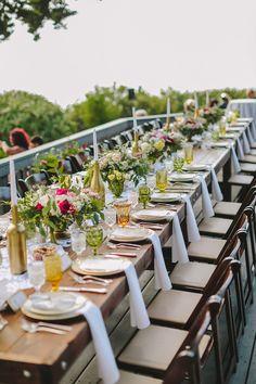 family style reception table, photo by Orange Owl Photography http://ruffledblog.com/a-whimsical-bohemian-wedding-in-la-jolla #weddingideas #tablescapes