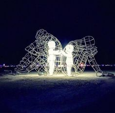 "Artwork from Burning Man ""I see it as two life long friends who in adulthood got into a fight over something. They are both being angry and stubborn, but deep down each cherish their friendship that started as children and want to make amends."""