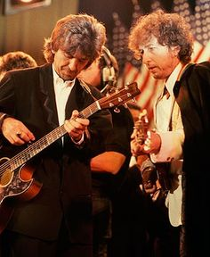 George Harrison and Bob Dylan perform at the 1988 Rock and Roll Hall of Fame Induction ceremony in New York City.