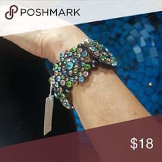 Free Shipping on Bundles! Bracelet Stretch multi-colored bracelet. New - never worn.💕 To get free shipping on bundles, send me a message listing the items that you'd like to purchase, then I will create a custom bundle listing for you and apply a $6 discount to the total amount due to me. Jewelry Bracelets