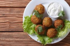 These tasty falafels are delicious served in pitta bread with a salad and Greek yoghurt. Veggie Recipes, New Recipes, Chickpea Recipes, Cooking Recipes, Favorite Recipes, Netmums Recipes, Vegan Gluten Free, Vegan Vegetarian, Delicious Magazine Recipes
