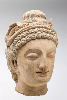 5th C. Kushan Period (100 BCE-250 CE) Stucco head.with Hellenistic facial features and the Kushan topknot. Kushan iranic Central Asian tribes forced out of the Tarim Basin who moved into Bactria and northern India. Their culture became multi-lingual. Originally Zoroastrian they also embraced local beliefs including Shaivite Hinduism and Buddhism. By the 3rd C. they had split into semi-independent kingdoms. Hadda, Afghanistan  Harvard Art Museums