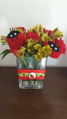Bring on the Spring. Ladybugs peeking through the flowers. Used a broken headband of my daughter's that was two stuffed ladybugs and added roses and yellow alstromeria. Week one at Metro Fine Arts Dance Studio