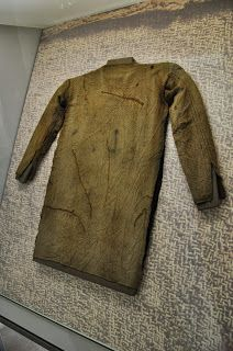 Tunic from Thorsberg, very well sewn. Made of wool woven in broken lozenge twill, with additional textile finish such as tablet woven edges . 4th cent.