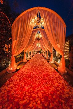 Entryway with Drapery, Chandeliers & Flower Petals | Photo: Ettore Franceschi.