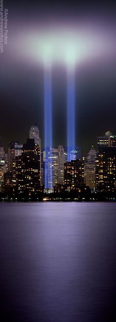 Tribute in Light A vertical panoramic view of the Towers of Light memorial in Lower Manhattan, New York City.