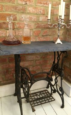 Singer sewing table, dining room, decanters, candelabra, slate