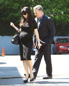 Pregnant Hilaria Baldwin shuns maternity wear as in a black midi dress #dailymail