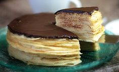 Custard-filled crepes cake with dark chocolate ganache topping