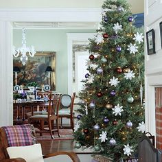 Lovely in Lavender:   Pick a color scheme your family loves or that matches your decor to inspire your Christmas tree's decorations. For a family who loves lavender, colored ball ornaments in lavender and complimentary colors are perfect for a simply decorated tree. A few strands of white lights, crystals, and snowflakes complete the serene look.
