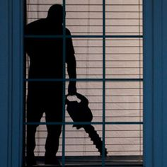 4. Murderous Window Silhouette | 5 Halloween DIY Projects That'll Scare The Crap Out Of Neighborhood Children