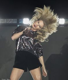 Hair-raising experience: While the skit aired, Taylor was taking the stage at the B96 Pepsi Jingle Bash at Allstate Arena in Rosemont, Illinois where she was giving her all with a hair-raising, dance-filled routine