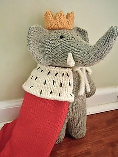 Babar stands 11 inches tall. He is knit in the round with worsted weight yarn, and in one piece from the neck down, so there is very little seaming required. The knitter has the option of making him with his trunk up or down; both versions are included in this pattern.  Gauge is not critical for a stuffed toy, but should be the same for both his body and his green suit, should you decide to make it.  Instructions for Babar, his green suit, a bowler hat, king's cape, and crown are all…