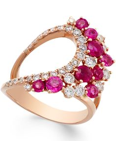 Rich in color and sparkle. This high-demand ring boasts a unique, openwork design bedecked with round-cut rubies (1-5/8 ct. t.w.) and full-cut diamonds (3/4 ct. t.w.). Crafted in 14k rose gold. | Phot