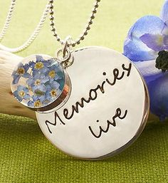 This beautiful Sterling Silver Pendant Necklace containing forget-me-not flowers is a perfect way to make memories live on.