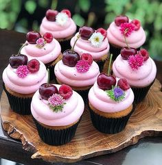 Cupcakes topped with cherries & raspberries