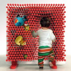 A shelf that will want to make kids clean up!  Kids just push their toys or books into this pin-type shelf.  Too cool!