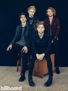 I'm dying right now!! I think they made Luke sit because he's the tallest and wants the other boys to look tall!!