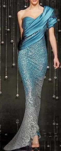Gorgeous by all means... sure to ensure you that striking entrance at any major event.  #gown #gala #blue