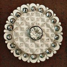 18th C. Carved and incised mother of pearl button with petal shaped edge and cut steel stone accents. Large, bezel set clear paste center stone.