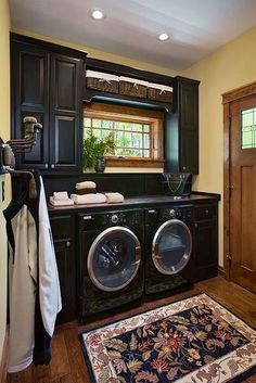 A Laundry Room that is So Functional and Amazing Looking. ♥ The Cute Little window to look out while Folding Laundry on the Countertop and The Dark Blue Cabinetry