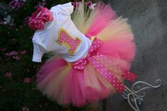 Pink & yellow tutu, onsie, and bow for her smash cake session!