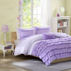 For the girl who loves polka dots, the Lindsey Comforter Set is perfect for you. The top three-quarters of the comforter feature a white ground with purple polka dots which the bottom quarter has purple ruffles with white polka dots. One purple decorative pillow features a geometric white embroidery pattern giving added interest to this collection.