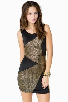 Super cute party dress, featuring an asymmetrical gold-flecked motif and scuba body.