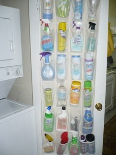 cleaning supplies in shoe organizer hung on back of door. space-saving idea.
