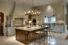 Kitchen, not so white, instead a soft, muted, warm, gray - greige.  One of my all time favorite kitchens. Segreto Finishes