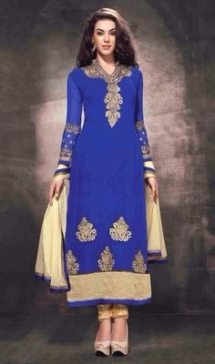 Create a buzz with this royal blue color georgette embrodiered churidar suit. The ethnic lace and resham work to dress adds a sign of elegance statement for the look. #prettyembroideredbuttadress #bluecolorstraightsuits #longchuridardresses