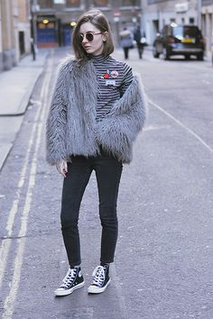 Get this look: http://lb.nu/look/8044806  More looks by Xenia Klein: http://lb.nu/xenia_antonina  Items in this look:  Zara Badge Top, Topshop Faux Fur Coat, Topshop Cain Jeans, Schuh Converse   #chic #edgy #minimal