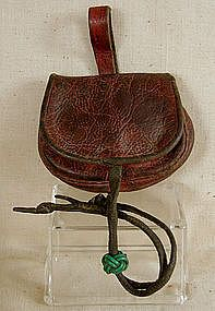 This charming antique purse from Tibet was hand-made to be worn hanging from a waist belt. Lacking ornamentation, is was probably a daily us...