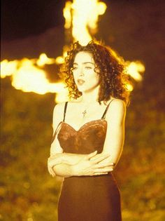 """thejoeboard: """" Madonna standing in front of burning crosses in the Like A Prayer music video, which was condemned by the Vatican in 1989 and voted the second best music video of all time by """" Madonna Hair, Madonna Songs, Madonna Videos, Madonna 80s, Madonna Photos, Le Vatican, Madonna Birthday, Madonna Like A Prayer, Walt Disney"""