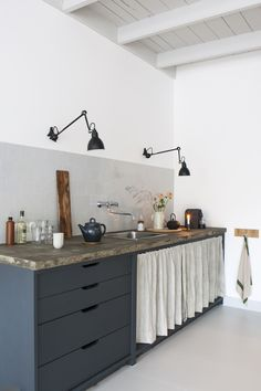Interior designer Christen Starkenburg's Interieur-Plus workspace/curtained kitchen at Jan de Jong, a design shop in Friesland, the Netherlands | Remodelista