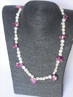white pearls with purple blister pearls