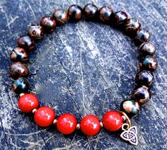 This unique bracelet was made of red coral, agate and gold plated Celtic knot. It brings good luck, harmony, balance, absorbs and neutralizes negative energy.