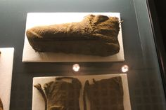 National Museum of Iceland  Reykjavik, Iceland - 2012  Mittens and sock made from woolen fabric cut and sewn into the garment as needed.
