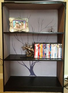 refurbished bookshelf, painted the branches by hand