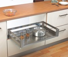 Satin Silent Pull Out Drawer door mounted  Pull out basket with anti scratch stainless base 35 kgs loading capacity Soft closing mechanism Also available in plain and with plate /bowl attachments This drawer includes heavy duty concealed runners