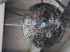 """Joe O'Connell and Blessing Hancock created an art installation underneath a San Antonio overpass called """"Ballroom Luminoso,"""" which utilizes recycled steel, bicycle parts and LED fixtures to create a brilliant chandelier display.   via #Inhabitat"""