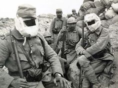 WWI, French soldiers, two of them with (early) gasmasks.