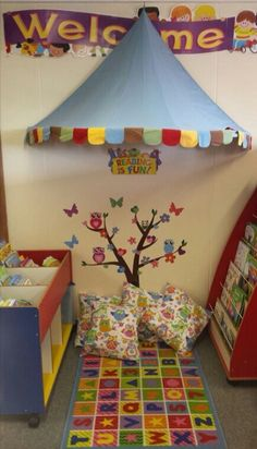 I love the tree, the owls and the welcome sign in this reading corner! The canopy on the ceiling looks like a circus tent! Classroom Reading Area, Classroom Layout, Classroom Organisation, Classroom Setting, Classroom Design, Classroom Displays, Classroom Themes, Preschool Rooms, Kindergarten Classroom